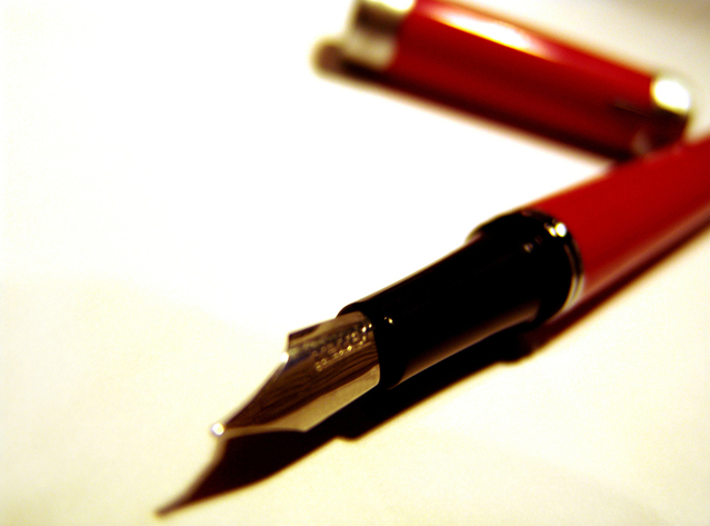 Image of an editor's red pen.