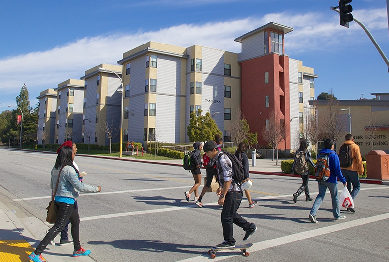Image of students crossing Harder Road by the Commons.