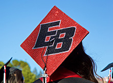 "Image of graduation cap with ""EB"" artwork."